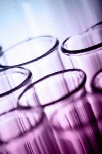 cluster of test tubes against a purple-blue background