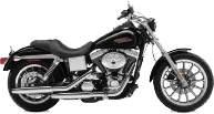 side-view of a black and silver Harley Davidson motorcycle