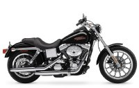 side-view of a black and silver Harley Davidson motorcycle on a white background
