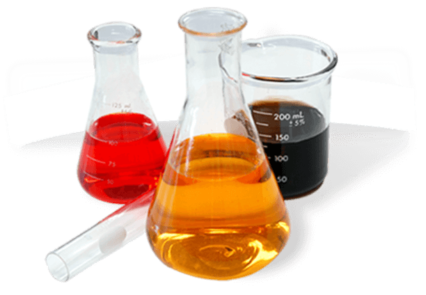cluster of glassware holding liquids; a small beaker with red liquid, a larger beaker with yellow liquid, and a 200 ml cup with black liquid