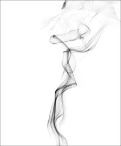 grayish black smoke vapors wafting upward on a white background