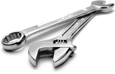 small crescent wrench on top of a larger crescent wrench