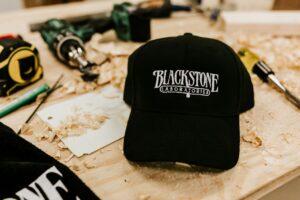 black adjustable hat with white blackstone logo