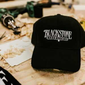 black adjustable hat with white blackstone logo