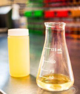 gasoline in a beaker and sample bottle