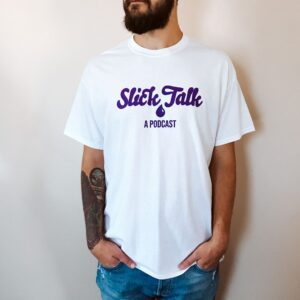 white t with purple Slick Talk logo on front