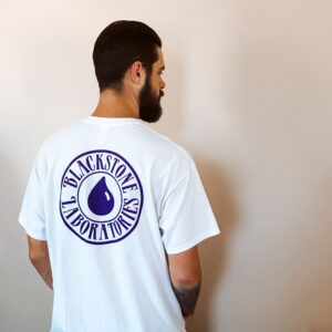 Blackstone logo in purple on back of white T shirt